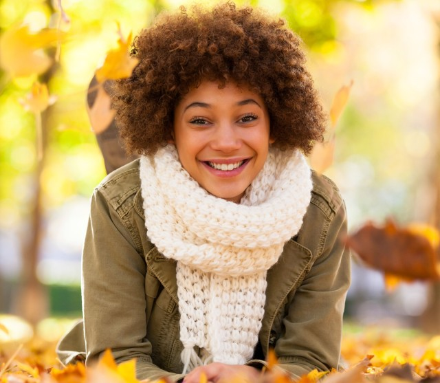 woman with natural curly hair in scarf, fall