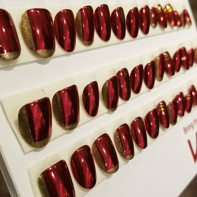 Image result for Red nails were all over designer Christian Siriano's 18th century-inspired presentation. It turns out the bold nails were achieved using KISS press on nails designed by Christian himself.